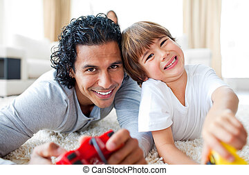 Animated father with his son playing video game lying on the...