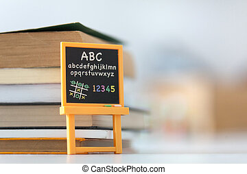 Blackboard in front of books