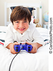 Happy boy playing video games