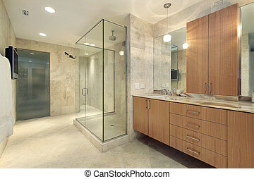 Master bath in luxury home with marble walls and floors