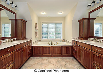 Master bath with wood cabinetry