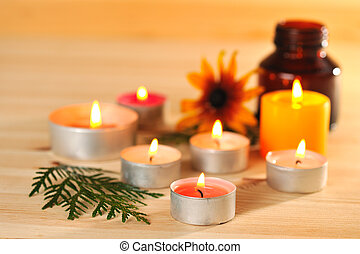 aromatherapy - burn scented candles with brown bottle with...
