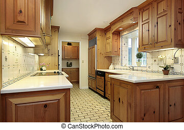 Country kitchen with wood cabinets and refrigerator