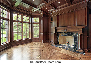 Library in new construction home with marble fireplace