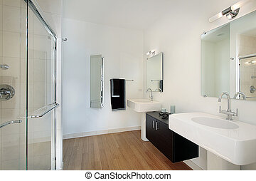 Master bathroom in condominium with glass shower