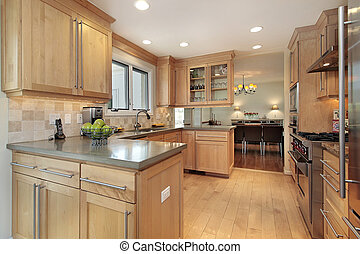 Kitchen with oak wood paneling - Kitchen in luxury home with...