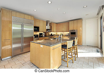 Wood cabinet kitchen with island and chairs