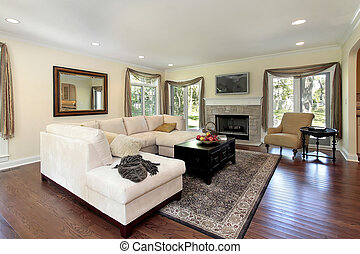 Living room with stone fireplace - Living room in luxury...