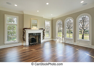 Living room in new construction home with marble fireplace