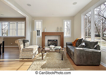 Living room in upscale home with view into dining area