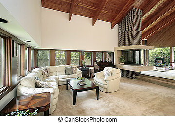 Living room with brick fireplace - Living room in luxury...