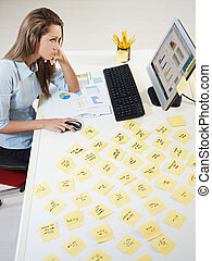 adhesive notes - tired business woman with adhesive notes on...