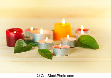 aromatherapy - colorful burn scented candles with green...