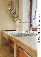 Solid kitchen sink and worktop - Close up of solid kitchen...