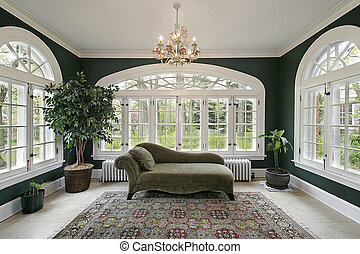 Sun room in luxury home - Sunroom in luxury home with sofa...