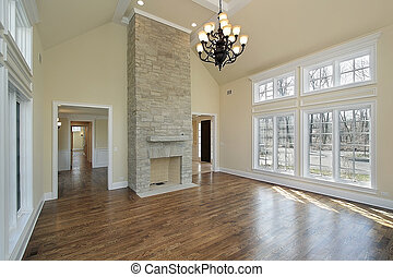 Living room with two story fireplace - Living room in new...