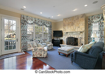 Family room in luxury home with door to patio