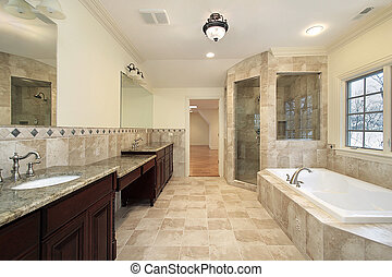 Master bath in new construction home with large tub
