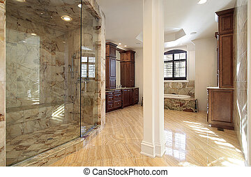 Master bath in new construction home with marble shower