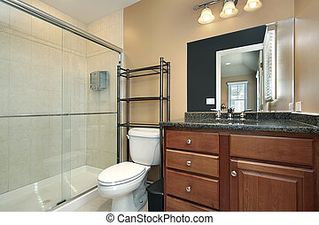 Bath with glass shower