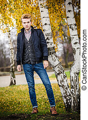 Young handsome man outdoors - Fall season and people concept...