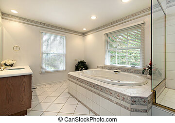 Master bath in remodeled home with large tub