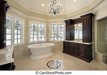 Master bath in new construction home with white tub