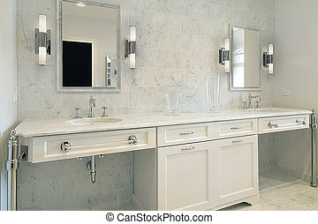 Upscale master bath with white cabinetry - Close up of...