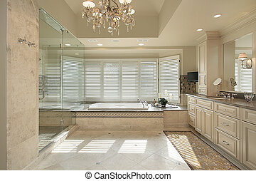 Master bath with large tub - Master bath in luxury home with...