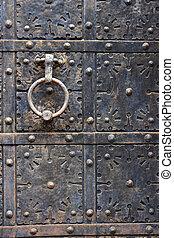 Old door handle on iron medieval door - Ancient iron door...