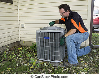 Repirman Tightening Fan Shroud On Outside Air Conditiong...