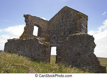 Wide view on ruin of house.