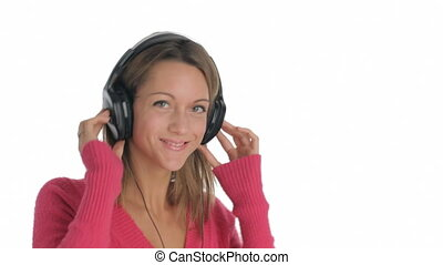 headphones - young woman listening to music on white...