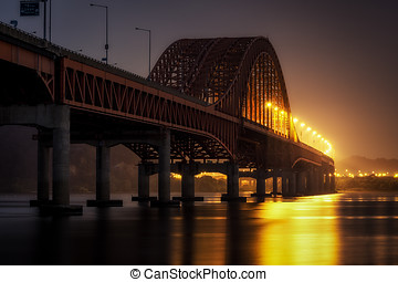 banghwa bridge at night over han river taken near the...