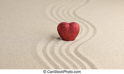 Red heart on a wavy sand, approximationHD