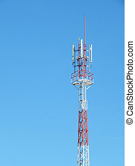 telecommunication tower red and white with blue sky background