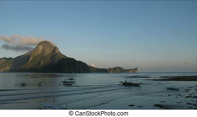 Sunrise in Philippines village - Sunrise in El Nido village,...