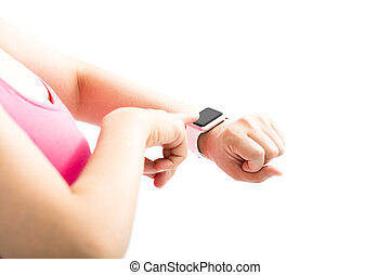 young woman finger touch the sports smart watch