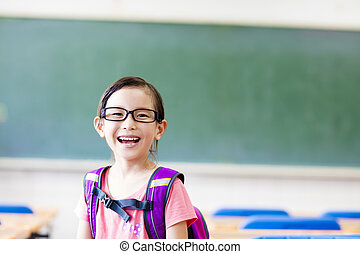 happy little girl in the classroom