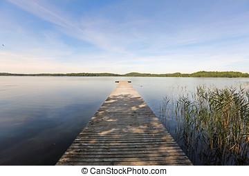 wooden jetty on Ungurs lake in Latvia