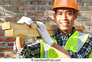 Crop images of man worker carrying wood smiling look on your...