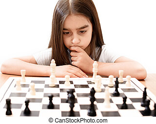 play chess - beautiful little girl concentrated playing...