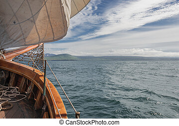 Sailing on the old boat towards adventures, summer time -...