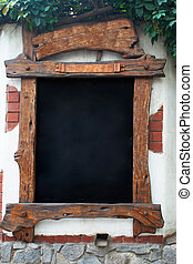 wooden sign - beautiful wooden sign on the stone wall