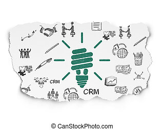 Finance concept: Energy Saving Lamp on Torn Paper background