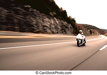 Speeding Motorcycle Woman - Abstract blur of a pretty girl...