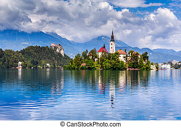 Bled with lake, island, castle and mountains in background,...