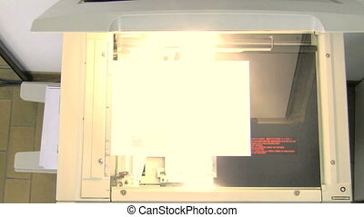 Photocopier scanning document High angle view 30p