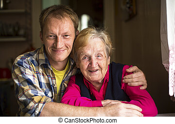 Elderly woman with adult grandson - Portrait of happy...