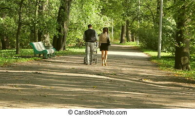 Young couple with baby carriage in Park